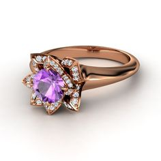 Round Amethyst 14K Rose Gold Ring with Diamond <3 Love the Rose Gold...oddly... and I always love amethyst. But its too big for my liking.haha