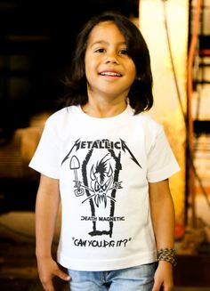 This little guy is really enjoying his #Metallica band t-shirt! Wanna be king of the playground? Check out: http://www.littlerockstore.com/metallica-kids-t-shirt-can-you-dig-it.html
