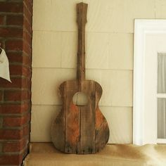 """This guitar wall art is made from reclaimed wood and is approx. 40"""" tall by 15"""" wide. All guitars are made to order from reclaimed wood so they will all look di"""