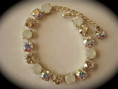 I make this bracelet with a variety of silver and opal Swarovski crystal 8 mm rhinestones. This bracelet has 15 stones and is about 6.5 long. I can make it in a variety of sizes, contact me for pricing. A matching necklace and stud earrings are av...