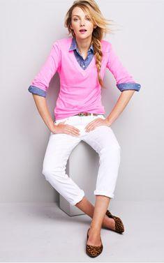 Denim under pink v-neck sweater, white jeans, animal print shoes