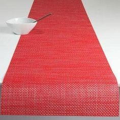 """Chilewich Basketweave Table Runner Red by Chilewich. $58.00. Approximate size: 14"""" x 72"""". Basketweave is considered by many to be the Chilewich signature weave. This traditional weaving pattern has been transformed into a truly modern aesthetic using a palette of contemporary neutrals which ranges from natural earth tones, through to lustrous metallic hues. Design: Sandy Chilewich. Approximate size: 14"""" x 72"""" Dining Table Runners, Dining Table In Kitchen, Weaving Patterns, Table Linens, Basket Weaving, Home Kitchens, Contemporary, Modern, Outdoor Blanket"""