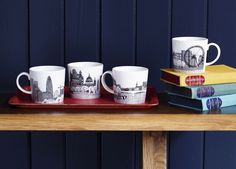 A perfect afternoon; a cup of tea with a good book.  The Scenic mugs from the Royal Doulton and Charlene Mullen range.