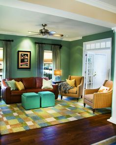 I LOVE this color scheme. This is perfect for a play room/family room. Compeltely switches up my original design and I'm okay with it.
