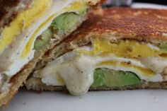 Grilled Avocado and Egg Melt Sandwich from @Nicole Cook {Daily Dish Recipes} http://dailydishrecipes.com/grilled-avocado-and-egg-melt-sandwich/