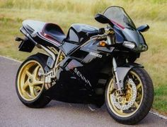 916 Senna, 1998 with gold five spokes.