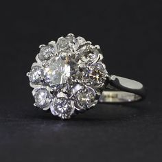 Pre-Owned 18ct White Gold Diamond Daisy Cluster Ring. The Diamonds In This Cluster Are An Excellent Colour, Making The Ring Shimmer And Sparkle. Estimated Diamond Weight 2.20 Carat Total. This Ring Can Be Viewed At Our Nottingham Store.