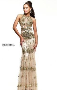 Wanting sparkle in gold on stage? This would be perfect for you!  Sherri Hill 9714