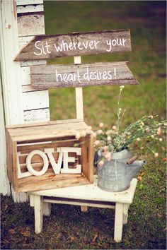 "Rustically vintage barn wedding. Love the wood boxes. I like this better than ""pick a seat not a side"""