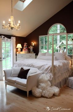 One lucky girl out there has a crazy talented mom who made her this amazing new bedroom! First of all, the room itself is gorgeous -- huge windows, vaulted ceilings and oh yeah, french doors to outside! Love the chocolate brown paint on the walls with all the white furniture. Beautiful room