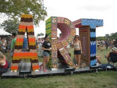 The Yarn Bombing folks did this in Austin. Giant letters covered in knitted yarn. Cool.
