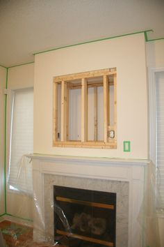 Patching up the TV niche above a fireplace.