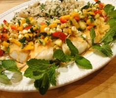 Succulent fish, bathed in a coconut milk sauce and smothered with a fresh tropical fruit salsa.