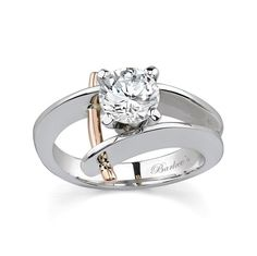 Unique with a twist of drama, this two tone diamond engagement ring sports a prong set round diamond center residing between the by pass shank.  A single rose gold wire trim arch beside the center diamond passing through the walls of the shoulders and protruding out slightly on the sides for an added touch of drama.<br /> <br /> Also available in white and yellow, 18k and Platinum.<br />