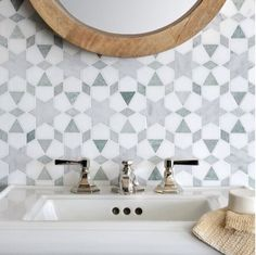Morrocan tile in a light blue bathroom via Kristina Bailey - tile accent wall in a half bath?