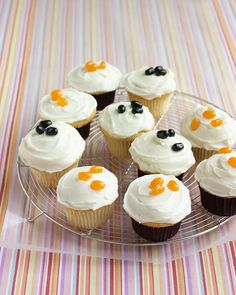 Top these frosted Halloween cupcakes with sweet orange jellybeans or creepy black ones.