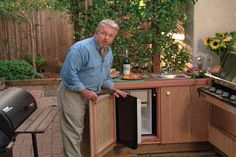 watch how to install an outdoor kitchen in your backyard, complete with rinsing sink, refrigerator and gas grill #diy #homeimprovement