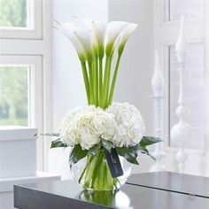 luxury cars - Luxury Calla Lily & Hydrangea Vase This contemporary designer arrangement is right on trend We've chosen ultrafashionable calla lilies in pristine white and created a surround of sumptuous hydrangea blooms with their richly textured flowers