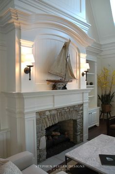 Moulding. What a gorgeous fireplace. Love the wall scones as well.