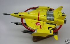 Manta Terran Spacecraft Desk Wood Model. Model from Terran Trade Authority books a science-fiction setting originally presented in a collection of four large illustrated science fiction books published between 1978 and 1980... A personal favorite from my youth...