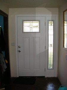 Beautiful white front door with 1/4 light and side light