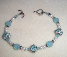 "Sterling Silver Plated Bracelet W/ Pacific Opal Swarovski Crystals & White Pearls. Fits a 7.5"" wrist."