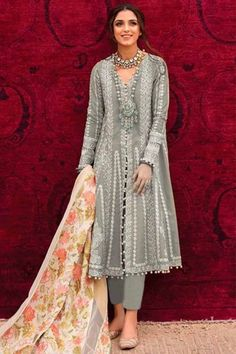 Enhance your ethnic charm by wearing this ash grey cotton trouser suit which will reflect the charm of high-end fashion. This v neck and full sleeve clothe designed using thread work. Accompanied by a matching santoon cigarette pant in ash grey color and off white net dupatta. Cigarette pant is plain. #trousersuit #salwarkameez #malaysia #Indianwear #Indiandresses #andaazfashion