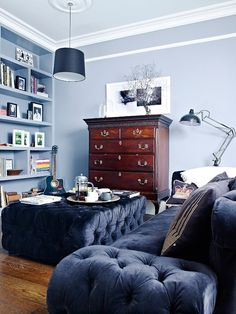 Blue grey colour scheme with velvet and wood