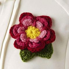 Crochet a spring flower to update your wardrobe. Find the pattern in the CraftHub app!
