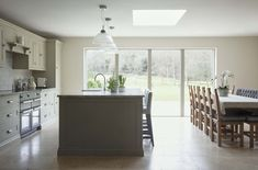 This kitchen is such a bright and light place to be even on the dullest of days. Very carefully chosen colours show you can choose two similar shades and create a striking difference between the island and the rest of the cabinetry. Kitchen Cupboard Storage, Above Kitchen Cabinets, Small Kitchen Storage, Kitchen Worktop, Kitchen Cabinet Doors, Upper Cabinets, Kitchen Shelves, Storage Spaces, Storage Ideas