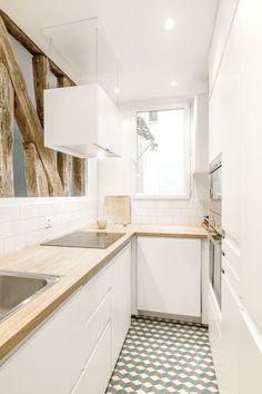 Avant/après : un 71 m2 parisien. La cuisine épurée et son sol en carreaux de ciment