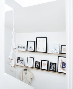 Frames on a picture ledge.