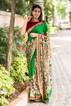 A fresh take on the Kalamkari vibe! A striking green crepe saree richly hand painted with Kalamkari art with our never fail detail magic in the form of a slim brocade border and gold lace edging. A truly vibrant and complimenting piece of Kalamkari this... A maroon blouse to shine bright. Or do a blouse in any one of the kalamkari colors to flaunt your inner stylista. #kalamkari #green #crepe #saree #India #blouse #houseofblouse