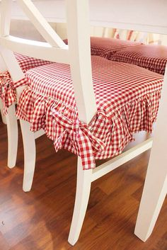 I LOVE these red gingham seat covers.used to have a red and white kitchen--maybe that will be the plan again someday!Wonderful cozy red gingham seat cushions add such charm to these chairs! Red- February is American Heart Month & December is World Ai Kitchen Chair Cushions, Kitchen Chairs, Seat Cushions, Red Dining Chairs, Red Chairs, Dining Chair Seat Covers, Kitchen Chair Covers, Dining Chair Pads, Dining Chair Slipcovers