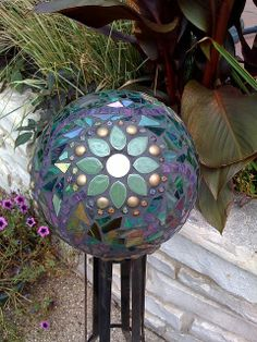 Repurposed old bowling ball,millefiori,ceramic leaves,mirror,stained glass,glass globs