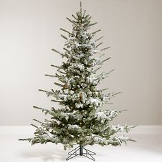 Dreaming of a white Christmas? This gorgeous Christmas fir tree has a generous sprinkle of snow on its branches for an authentic looking white Christmas theme.