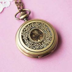 Romantic Pocket Watch Necklace - BONUS PACK with Baby Loves Pink Pin Badge and Gift Wrap by Baby Loves Pink. $25.00. Breath taking piece of antique style pocket watch necklace. The front cover of this watch has beautiful lacy filigree patterns.  Simply press the top notch to reveal the face of the watch.  * The watch's default battery may run out during storage or by the time it's received. The watch will be fully functional when new battery is added again. Please a...