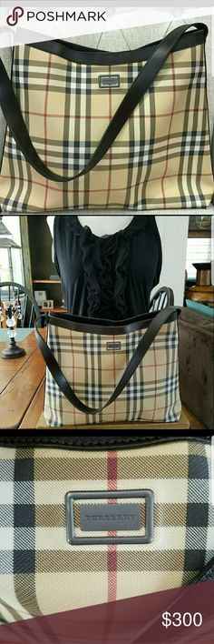 🌌 Gorgeous Burberry Bag 🌌 This is a gorgeous Burberry bag in excellent used condition. Trimmed in chocolate brown leather, and has beautiful metal Hardware. The Classic Nova Check pattern. It has one deep zipper pocket inside with a leather pull and lined with chocolate Burberry lining. Please see pics for bottom of the bag. Each corner has very small rubbing which is known to happen on corners of Burberry bags & there is a very faint mark on front, which is not noticeable to the eye. But…