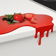 """GREAT Bloody hell! A """"dripping"""" cutting board :: Hot Mess Kitchen Gadgets  from ThinkGeek   ...Having now bought this, It bears noting; the """"drip"""" (which is removable for flat storage) hangs below the counter top and in front of the drawers, making opening a challange.  But works perfect in front of a dummy drawer or on a thicker counter surface like a butcher block or on a table"""