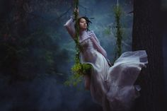 I love the ivy covered swing and the mist and her flowing white dress.