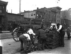 Granville & Davie, ca. 1912 Men loading wood paving bricks during the reconstruction of the Granville streetcar line.