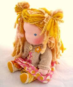 Marigold, a Waldorf doll by TumbleberryToys. Handmade doll, with handspun dreadlocks, Amy Butler dress, handknit sweater out of soft fluffy Angora/merino.