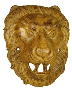 Bronze plaque of a fierce lion with full mane, hollow in the back. Holes on the sides. Brown patina. 100-200 AD