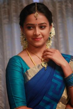 Sri Divya Looks Sweet and Sophisticated in a Simple Blue Saree with Gold Jewelry and Jasmine Flowers