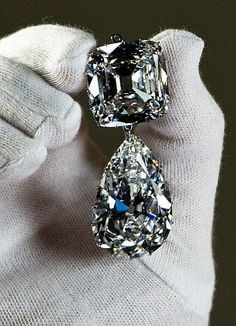 "Cullinan III and IV Brooch. The third and fourth largest of the gems: a pear-shaped drop of 94.4 carats known as Cullinan III and the cushion-shaped 63.3 carat Cullinan IV, both from original cleaving of a 3000 carat rough found in South Africa in 1903. They were originally placed by Queen Mary on her new crown in 1911. Now owned by Queen Elizabeth II as part of the Crown Jewels, lovingly referred to as ""Granny's Chips."""