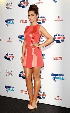 Cheryl Cole (Emma) in a bright orange mini dress, keeping accessories to a bare minimum and letting the striking heels do all the talking.