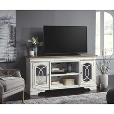 Signature design by ashley home entertainment xl tv stand w/fireplace option at barron's home furnishings Furniture, Farm House Living Room, Large Tv Stands, Ashley Home, Fireplace Option, Living Room Decor, Rustic Living Room Furniture, Fireplace Tv Stand, Rustic Living Room