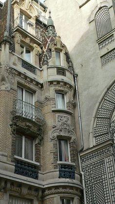 Parisian architecture::corner turret on art deco building