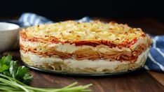 Recipe with video instructions: Because spaghetti pie was so last season, enjoy it now in cake form with layers of pasta, bolognese, mozzarella, ricotta and more. Ingredients: 1 pound spaghetti noodles, cooked al dente, 3 eggs, beaten, 2 cups whole milk ricotta, 1 (8-ounce) package mozzarella slices, 2 cups bolognese sauce, cold, 1/2 cup shredded mozzarella, 1/4 cup Parmesan, grated, Salt and pepper, to taste, Parsley, for garnish