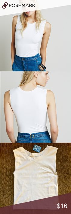 🆕 FP Stretch Crop Muscle top New with tags! American made soft and stretchy cropped high neck seamless tank. A great layering piece! True to size. Price firm unless bundled. Free People Tops Crop Tops